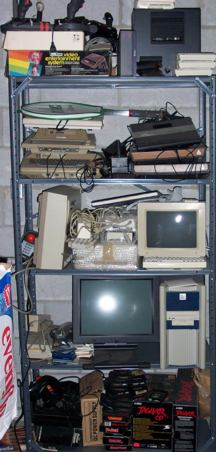 Shelf of old videogames and computers